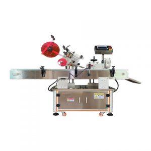 Automatisk etikettmaskin för runda föremål